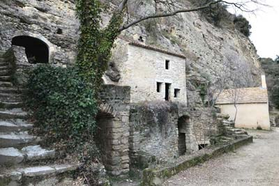 Steps, caves, houses and chapel at