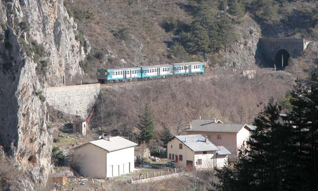 A train passing between tunnels, near