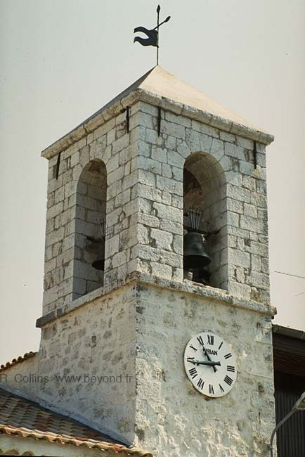 The stone bell tower in Andon village, photo