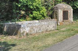 Old covered well and open lavoir