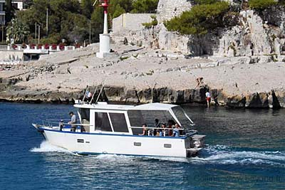 A small Calanques tour boat out