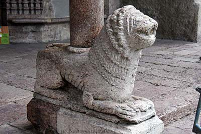 One of the carved lions supporting