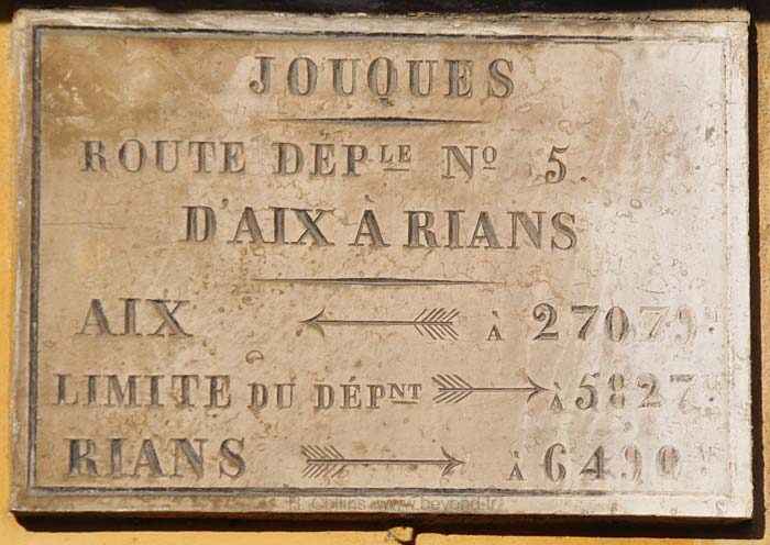 Ancient road sign at Joques, Aix