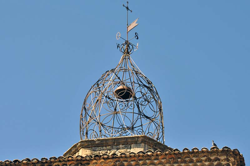 This remarkable wrought-iron campanile tops