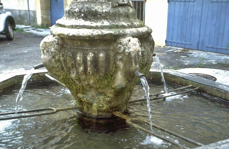 Ancient stone fountain on Place de