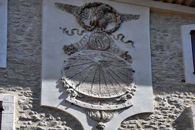 Large stone sundial with eagle, in
